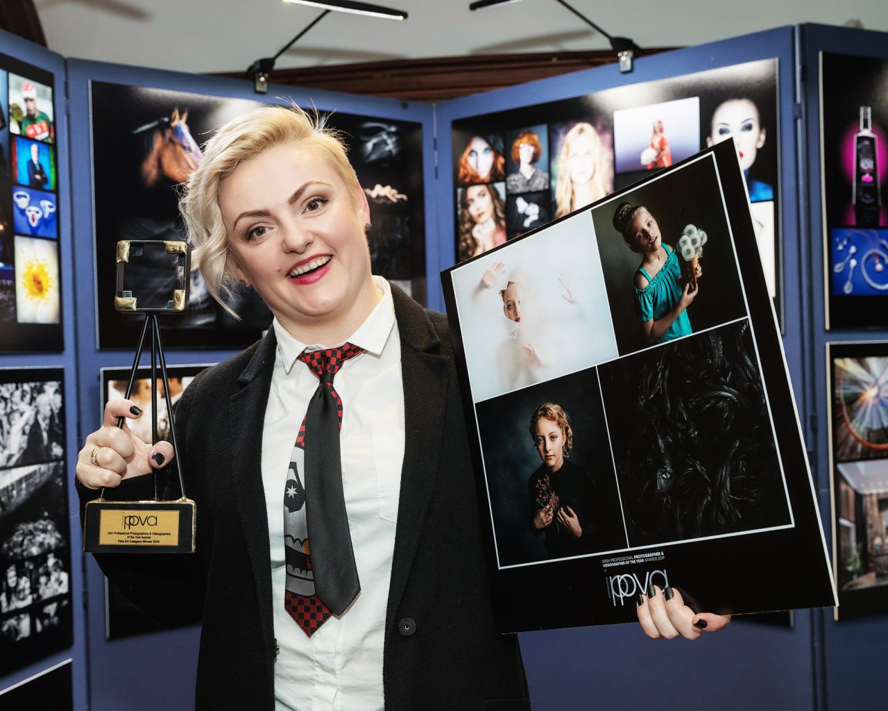 Greta smiling while holding her trophie at the Award Gala in 2019