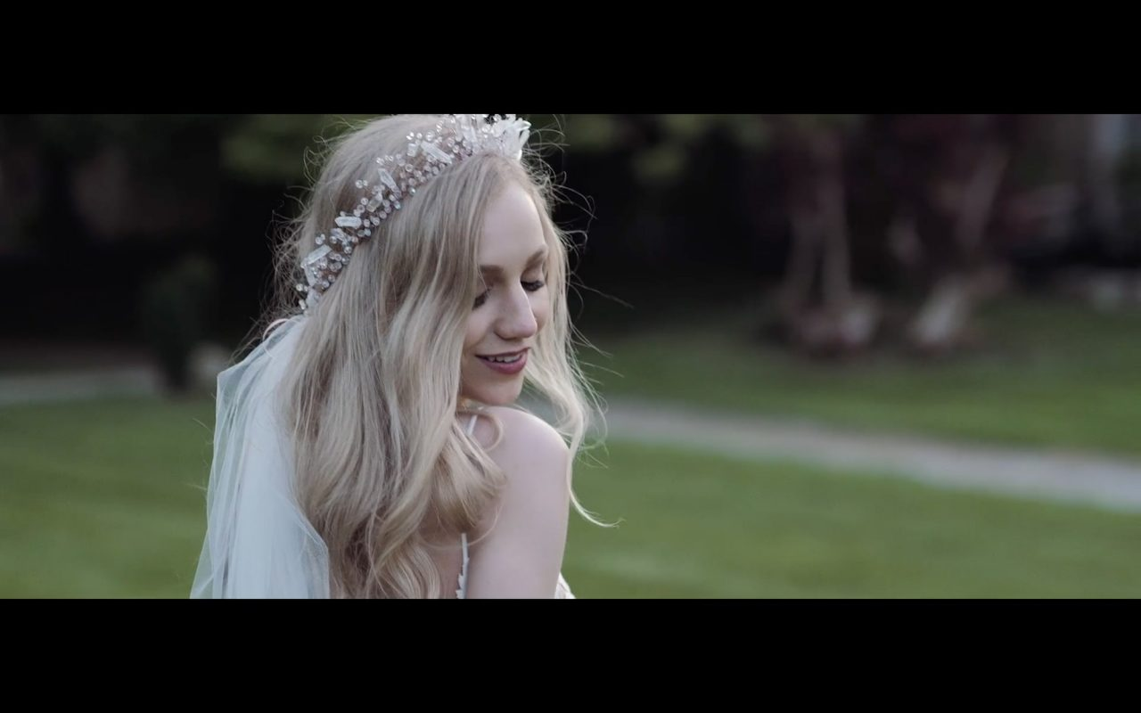 Bride looking over her shoulder - Still from a wedding film by Gavin Gallagher