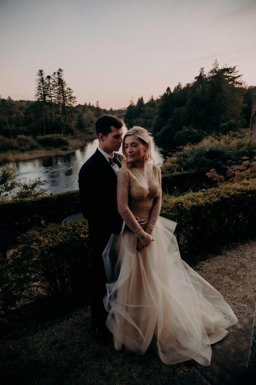 Bride and Groom posing for wedding photos in Connemara, Ireland