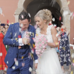 bride and groom getting showered with confetti outside of a church