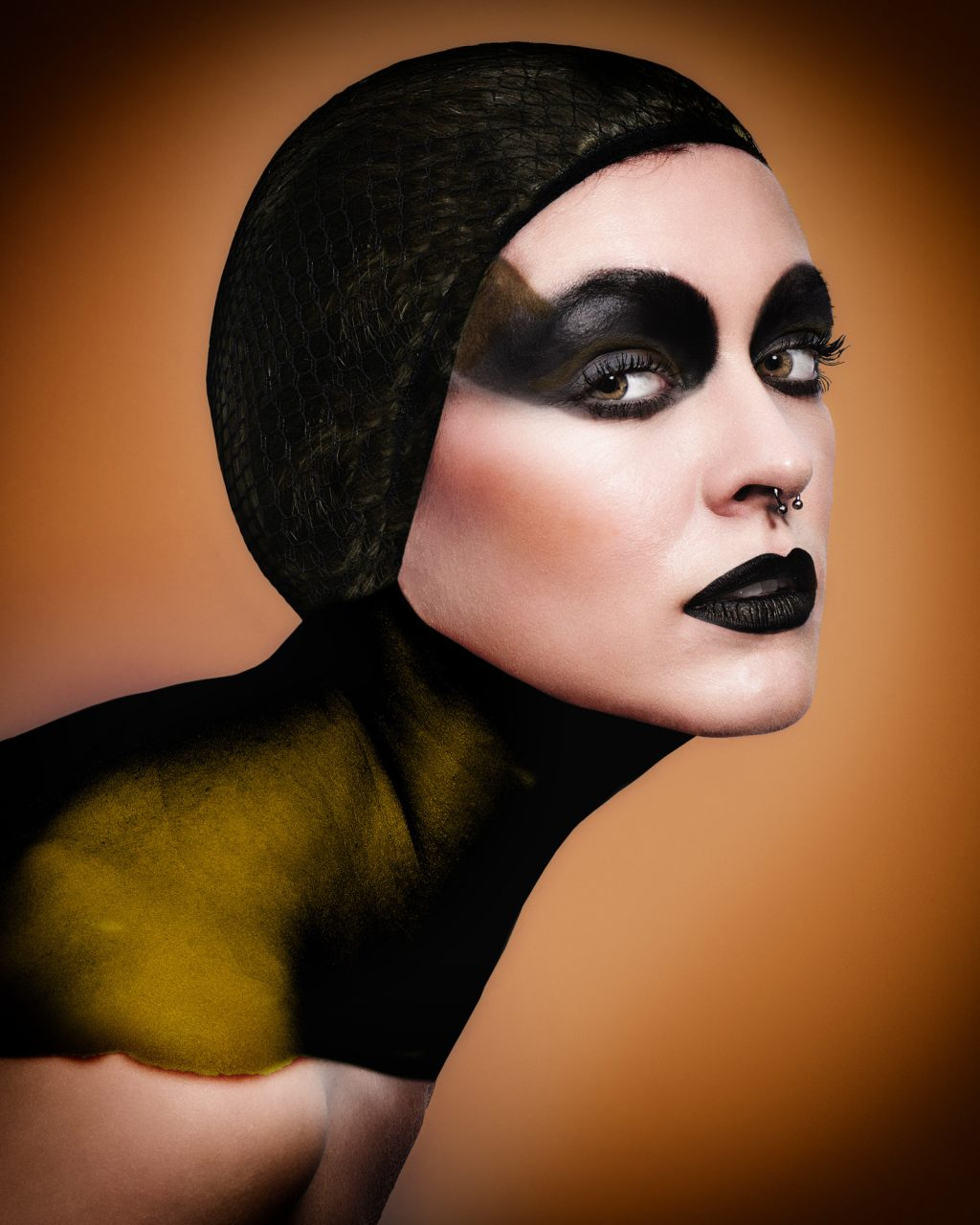 Portrait of a model with dramatic black makeup - Gold Award in Commercial Photography by Michael Hayes
