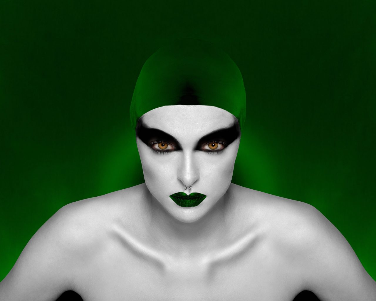 Portrait of a model with dramatic makeup and green swim hat - Gold Award in Commercial Photography by Michael Hayes