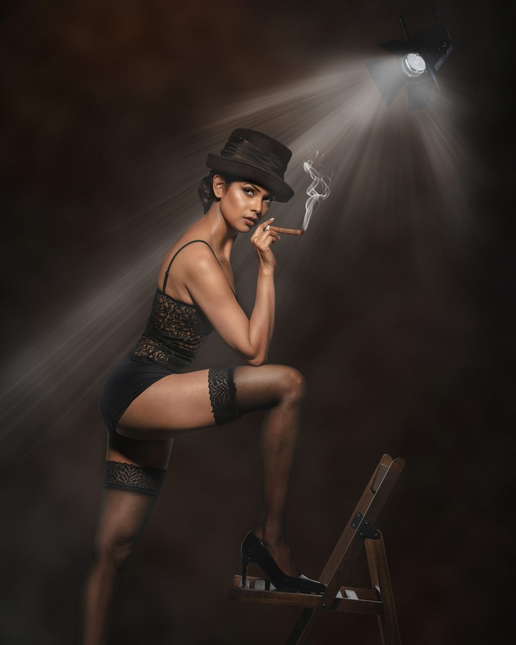 Portrait of a model smoking cigar - Silver Award in Commercial Photography by Michael Hayes