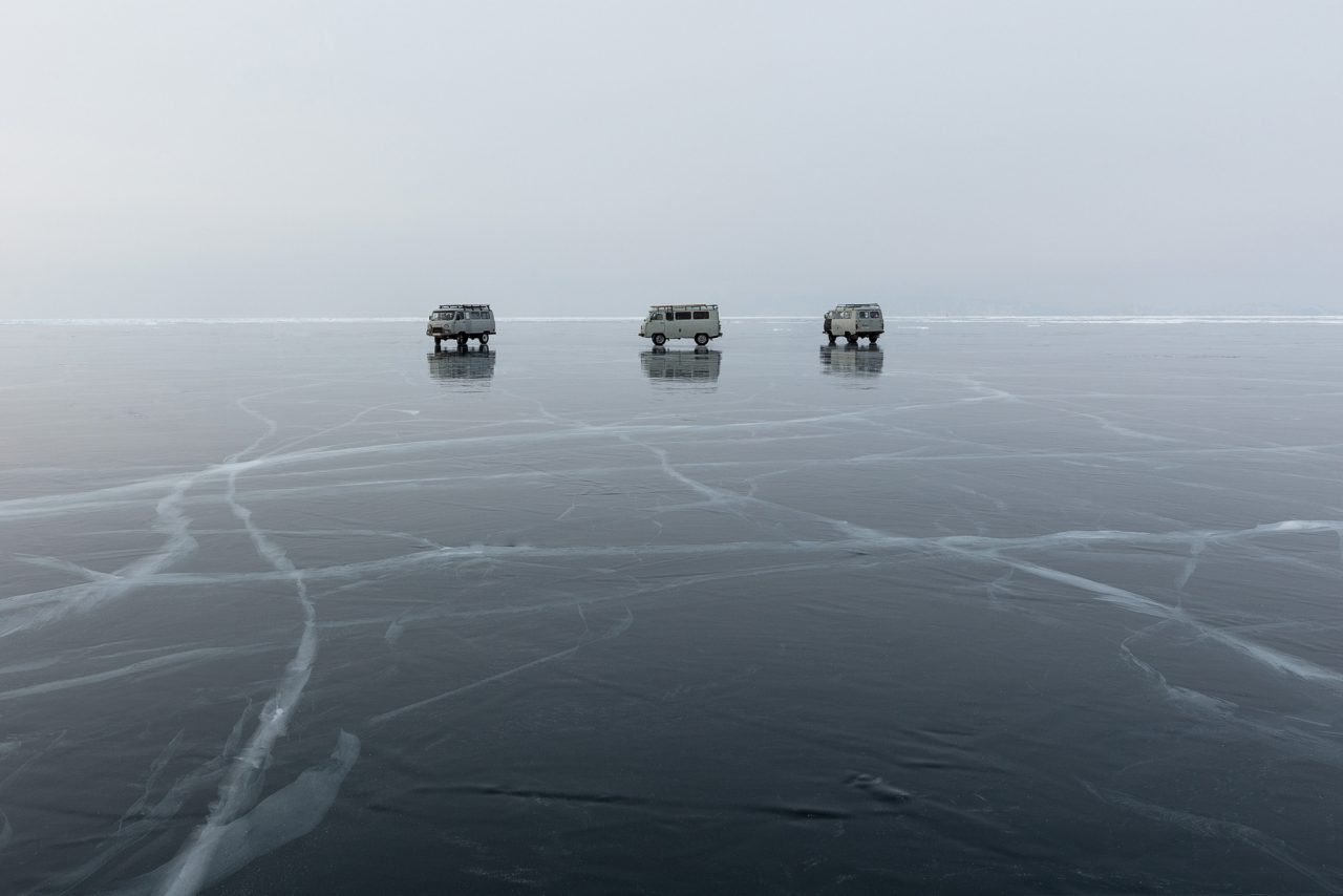 Three vans on the ice of Lake Baikal - Photography by Daragh Muldowney