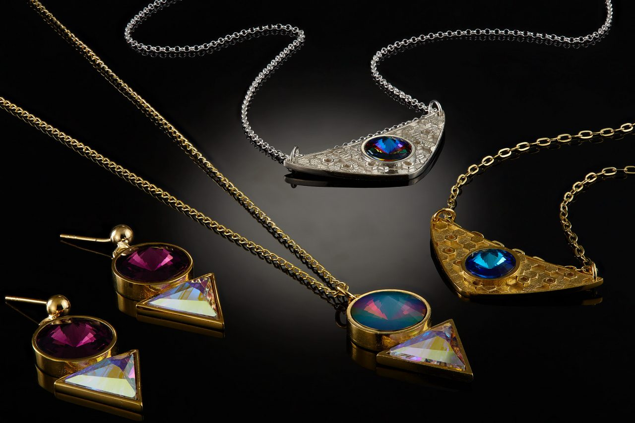 gols and silver necklaces and earrings  with jewels