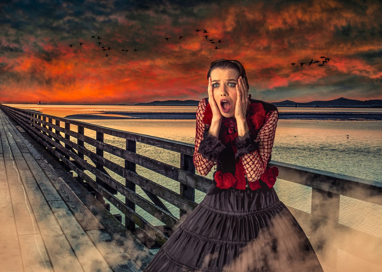 photographic recreation of Edvard Munch's painting, The Scream. Photographed with a woman screaming on a wooden pier