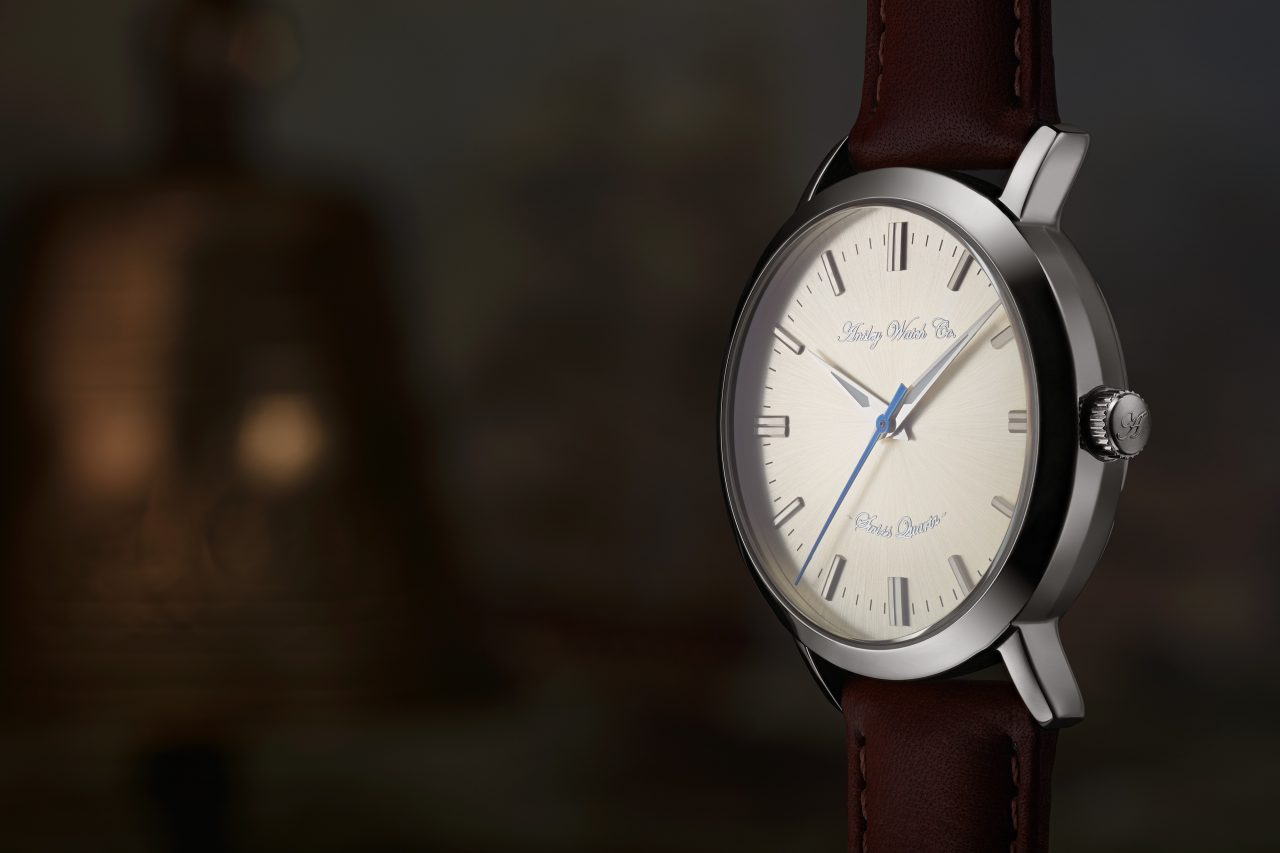single designer watch facing left with lots of negative space on the left