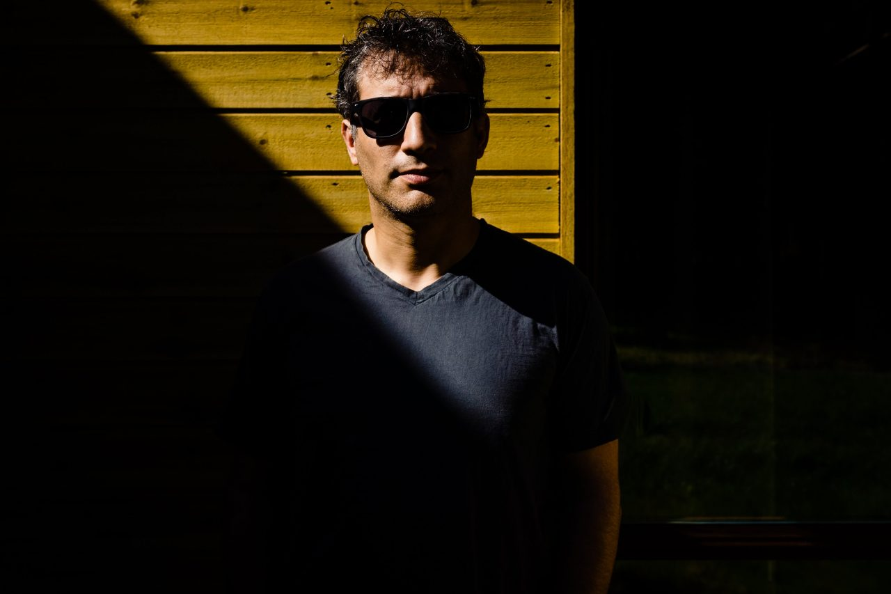 high-contrast profile photo of a photographer with sunglasses