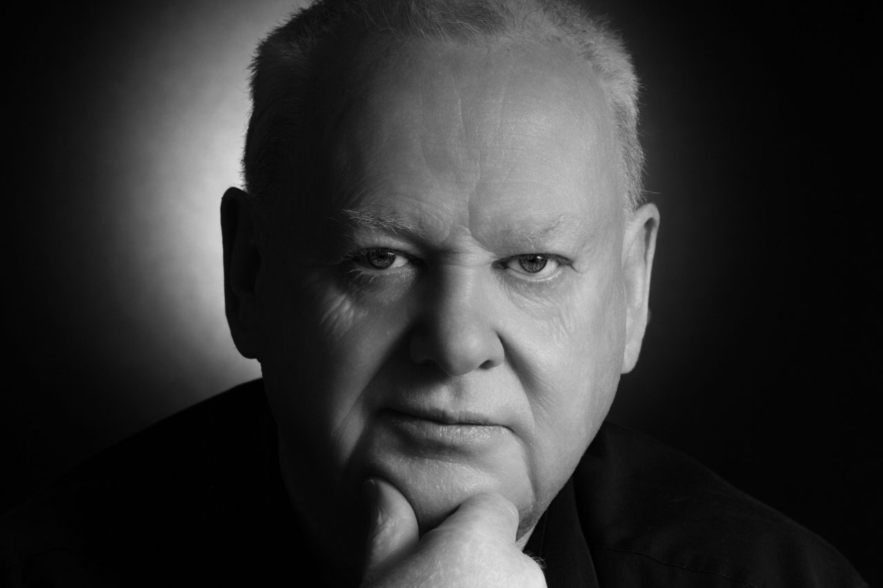 black and white portrait of a mature man looking at the camera