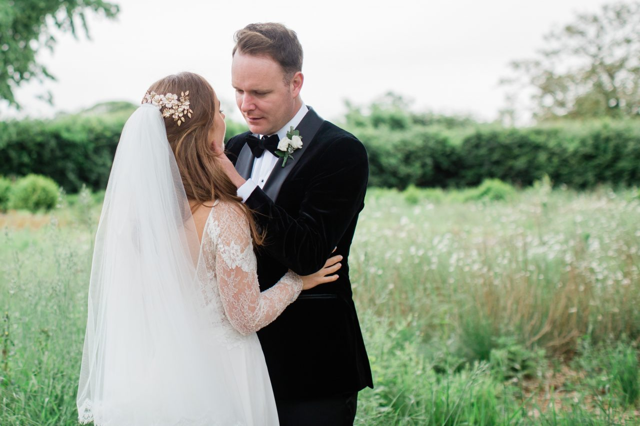 groom holding the face of his bride