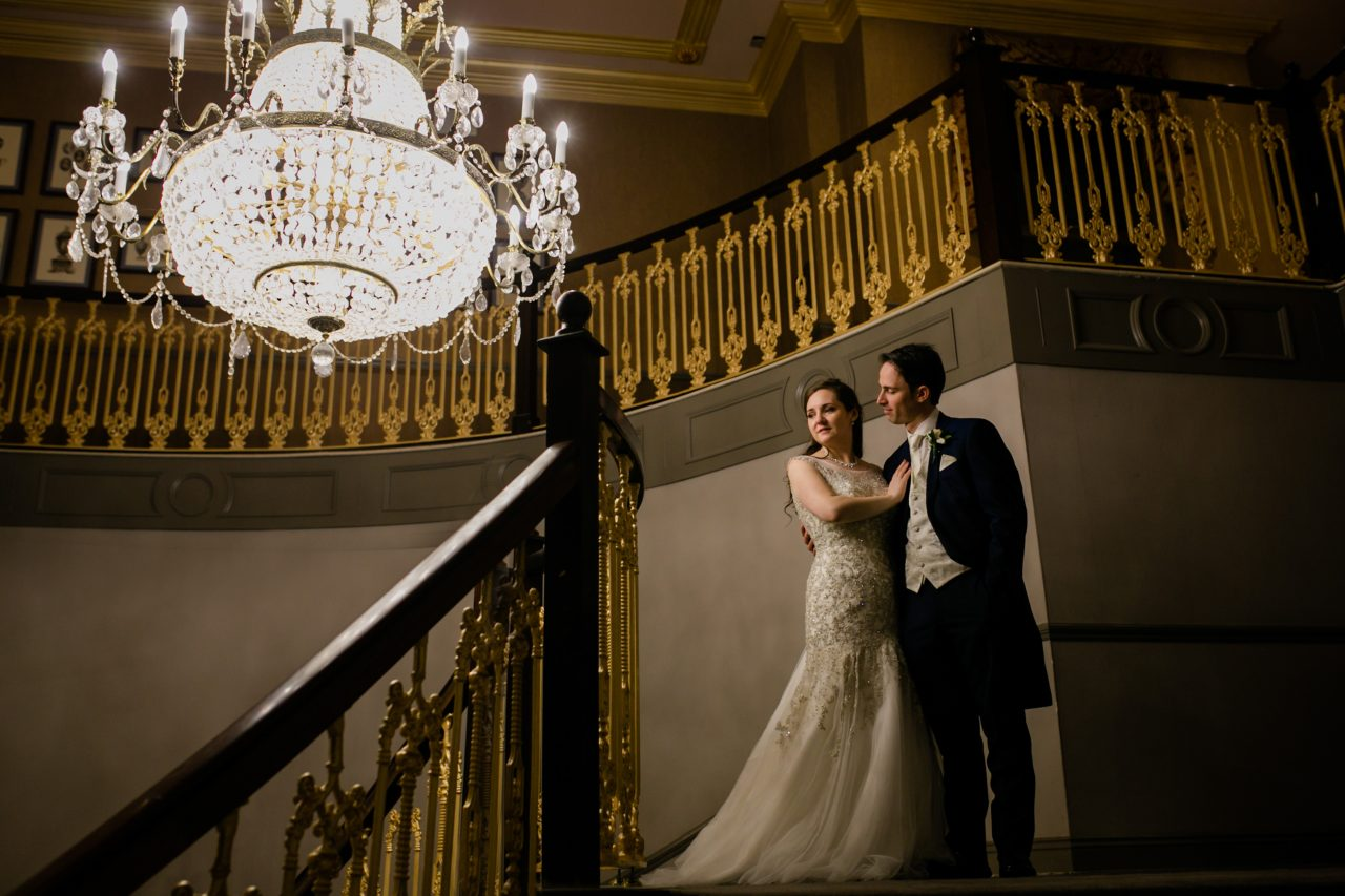 Brind and groom at the top of a stairs
