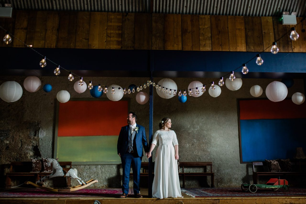Bride and groom portrait on a theater stage